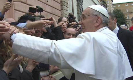 Newly elected Pope Francis greets crowds before his Angelus prayer in the Vatican