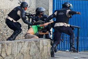 National police detain an anti-government protester during clashes at Altamira square in Caracas